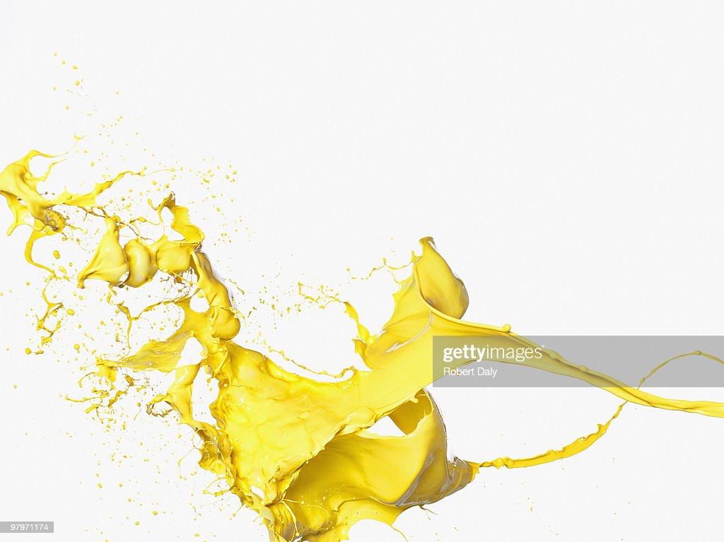 Yellow paint splashing : Stock Photo