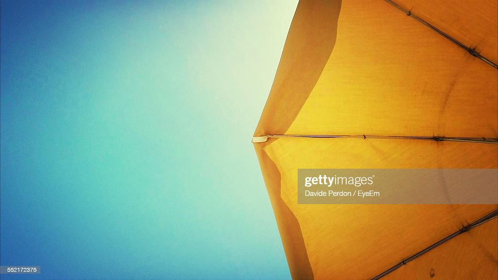 Yellow Parasol Against Blue Sky