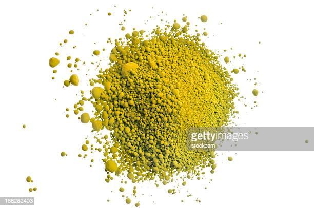 Yellow pile of pigment powder on white