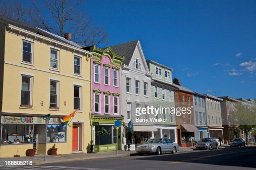 Yellow, pink, grey and green building facades