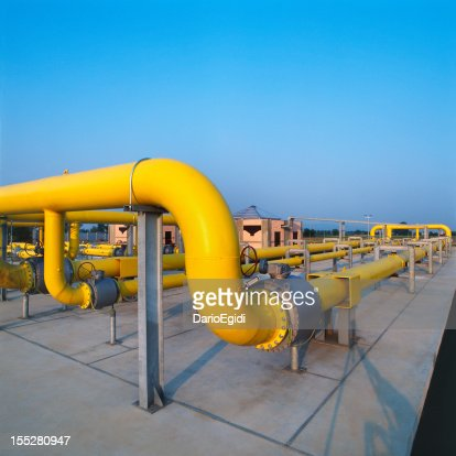 Yellow pipes in a gas distribution station, blue sky background