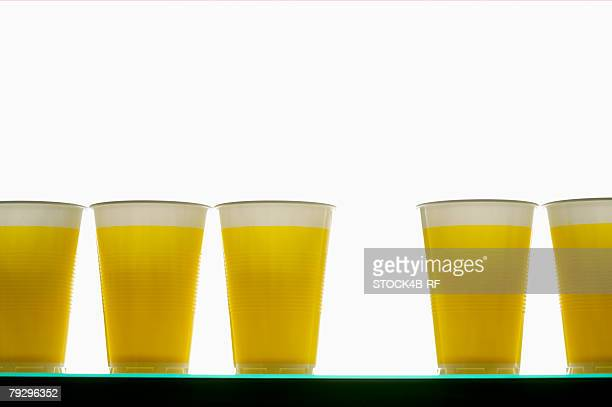 Yellow plastic cups in a row