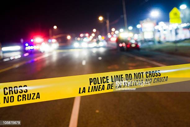 Yellow police line blocking off crime scene investigation