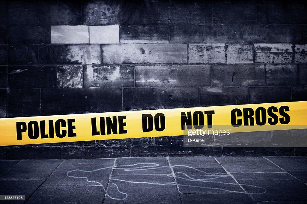 Yellow police line on crime scene : Stock Photo