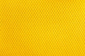 yellow polyester nylon sportswear shorts to created a textured background.