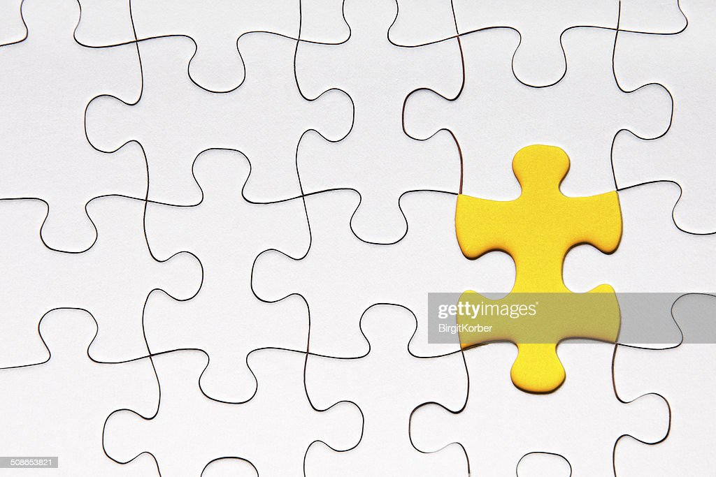 Yellow puzzle piece : Stock Photo