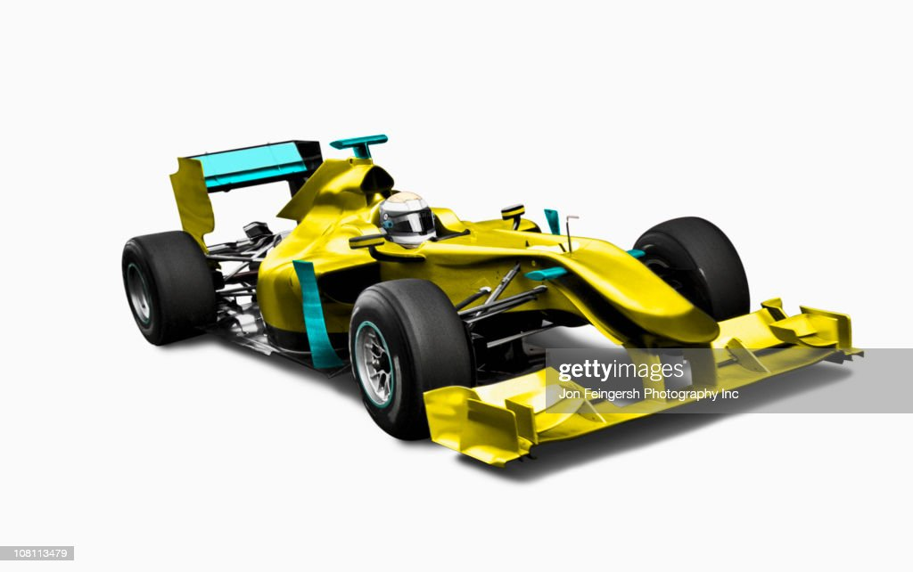 Yellow race car with driver : Stock Photo