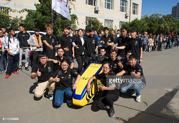 A yellow racing car makes its debut at Changchun University on September 28 2016 with its developers in Changchun Jilin Province of China Three...
