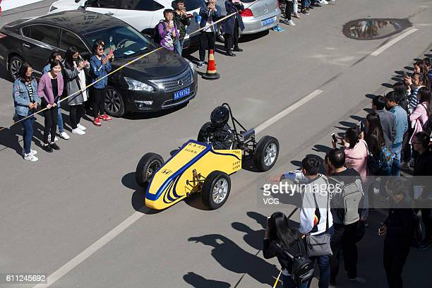 A yellow racing car makes its debut at Changchun University on September 28 2016 in Changchun Jilin Province of China Three college teachers and...