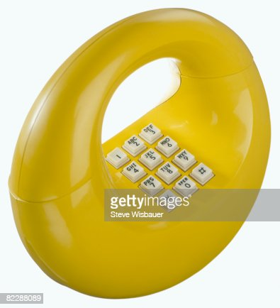 Yellow retro 1970s hoop donut or loop telephone : Stockfoto
