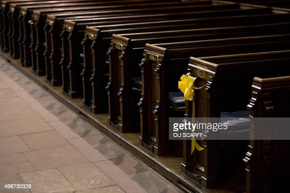 A yellow ribbon is tied to the end of a pew in Eccles Parish Church following a service of remembrance in Eccles in Greater Manchester northwest...