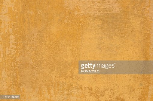Yellow Roman grunge texturized wall background in Rome Italy