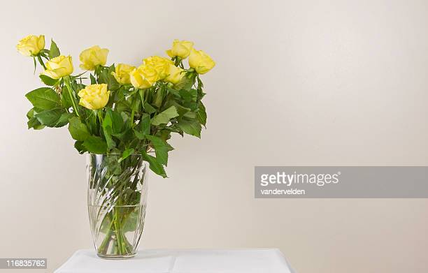 Yellow Roses On A White Table