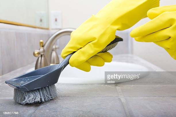 Yellow Rubber Gloves and Brush Cleaning Bathroom Sink