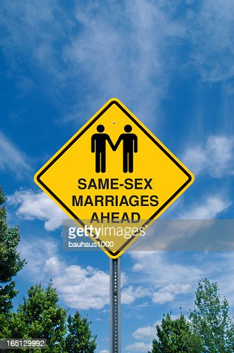 Yellow same sex marriage sign against a blue sky