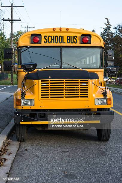Yellow school bus parked in a Toronto street Traditional Canadian school bus Vehicle used for safely transporting students to school in North America