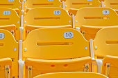 Yellow numbered empty seats.