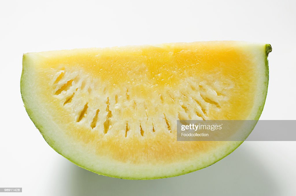 Yellow seedless watermelon on white background : Stock Photo