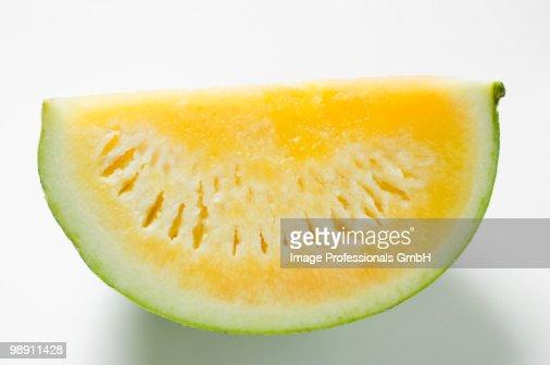 Yellow seedless watermelon on white background : Stock Photo