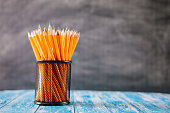 Yellow sharp pencil in black metal basket