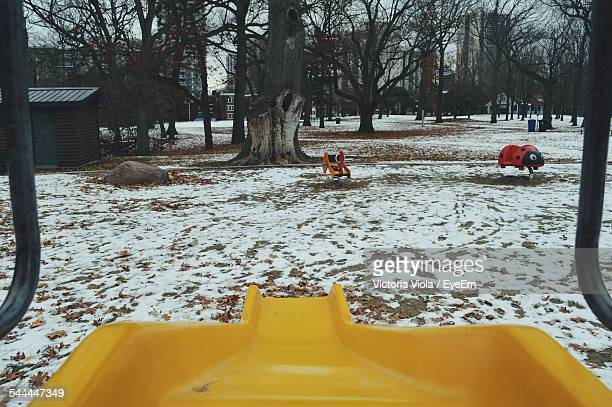 Yellow Slide In Playground During Winter