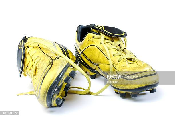 Yellow soccer cleats