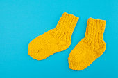 yellow socks on a blue background