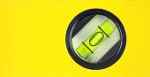 Yellow spirit level , macro image