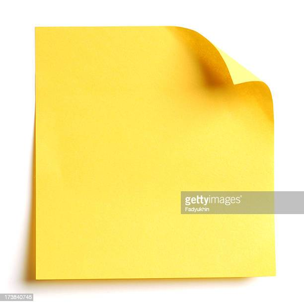 A yellow sticky note with the corner pulled
