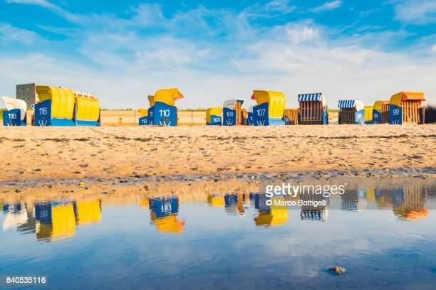 Yellow Strandkorb on the beach. Dunen, Cuxhaven, Germany.