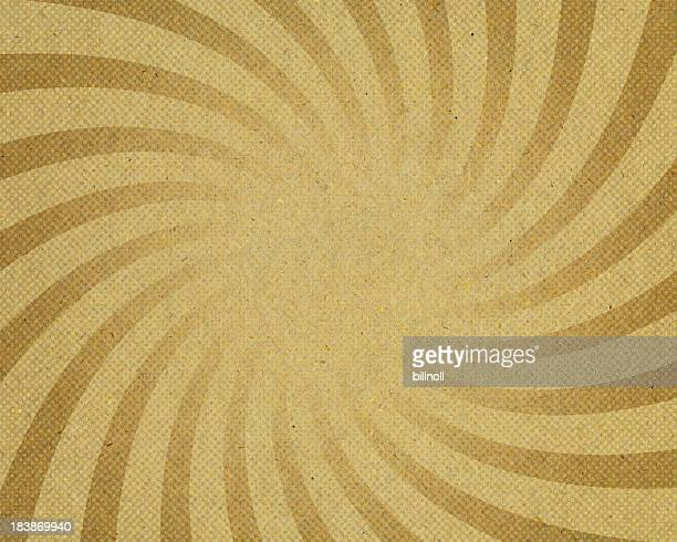 yellow sunburst twirl pattern on paper