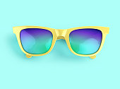 Yellow sunglasses with multicolor lenses on blue background. 3D rendering with clipping path