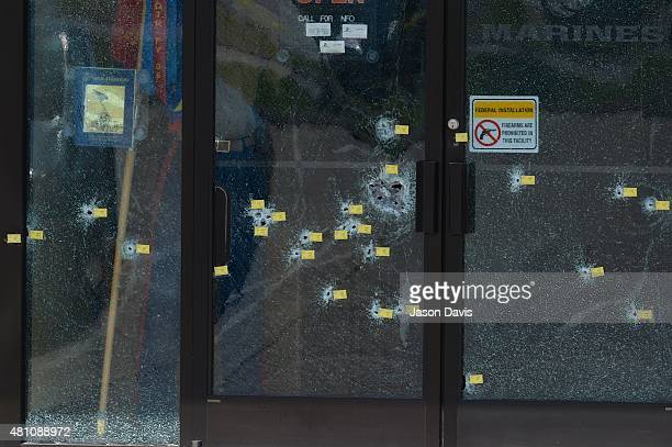Yellow tags mark bullet holes in the glass at Armed Forces Career Center/National Guard Recruitment Office on July 17 2015 in Chattanooga Tennessee...