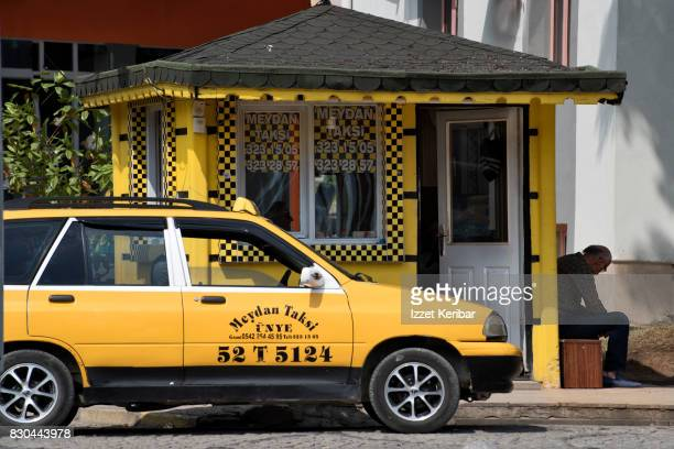 Yellow taxi  and  sieated  driver at Unye town, near Ordu. Turkey