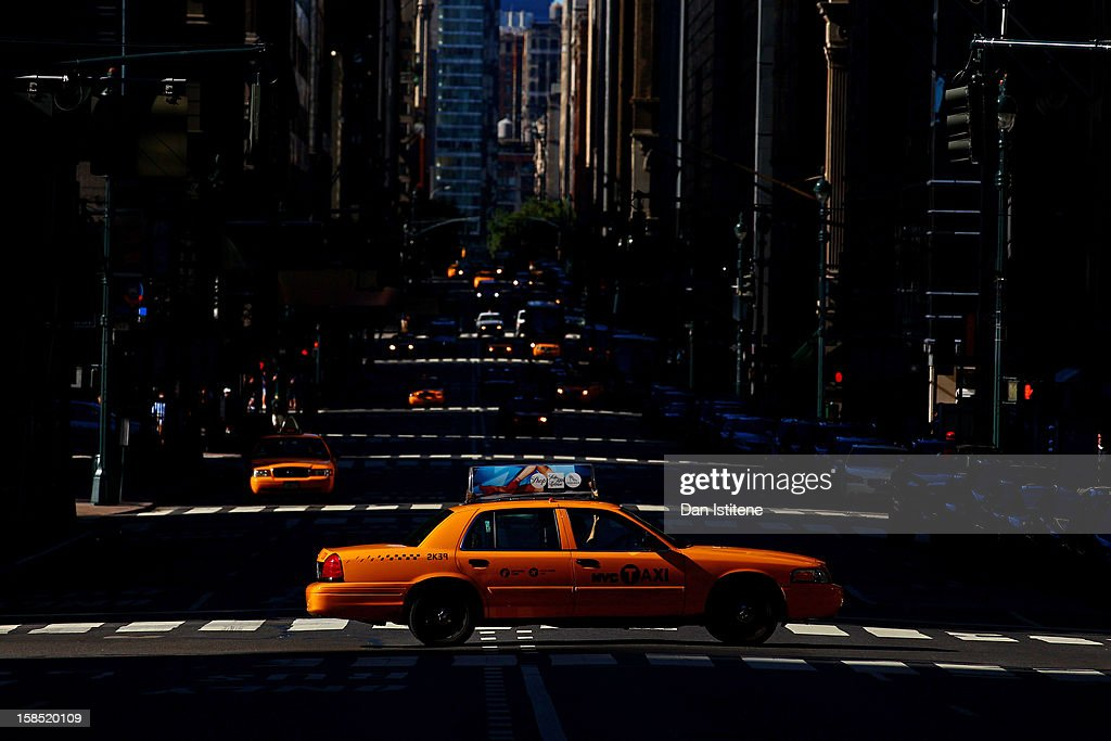 A yellow taxi cab crosses a street in Midtown Manhattan on September 9, 2012 in New York City.
