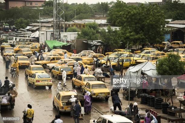 Yellow taxi cab drivers wait for customers in a parking lot in N'Djamena Chad on Tuesday Aug 15 2017 African Development Bank and nations signed...
