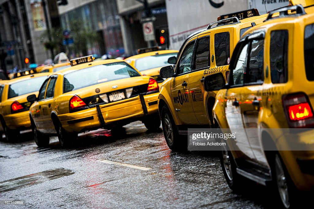 Yellow taxi cars in New York USA, On a rainy day in Manhattan down town. Rush hour.