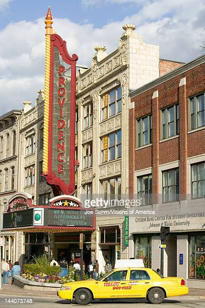 Yellow taxi drives by Providence Performing Arts Center marquee sign Providence Rhode Island
