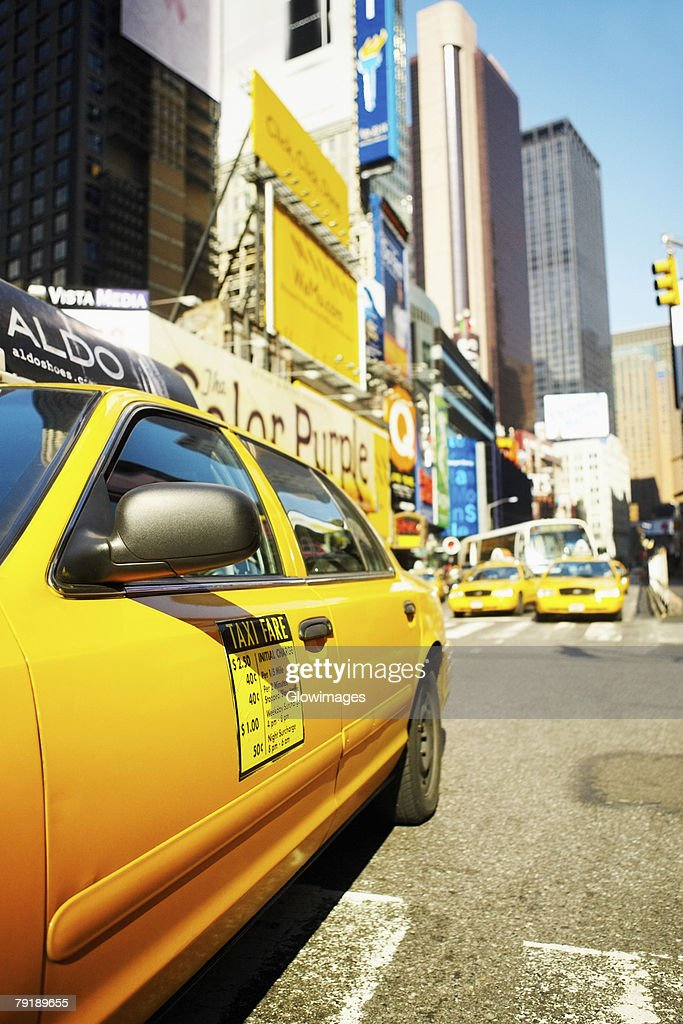 Yellow taxi on a road, Times Square, Manhattan, New York City, New York State, USA : Foto de stock