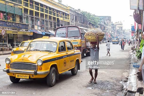 Yellow taxi on Kolkata street, India