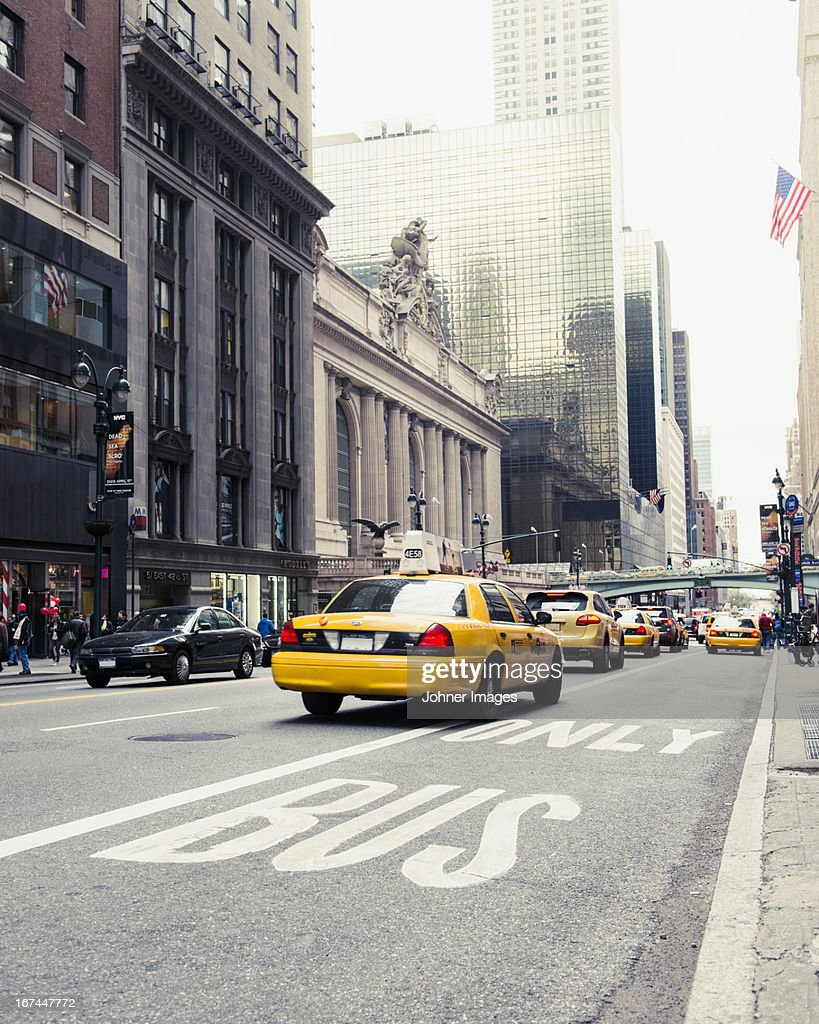 Yellow taxi on street : Stock Photo