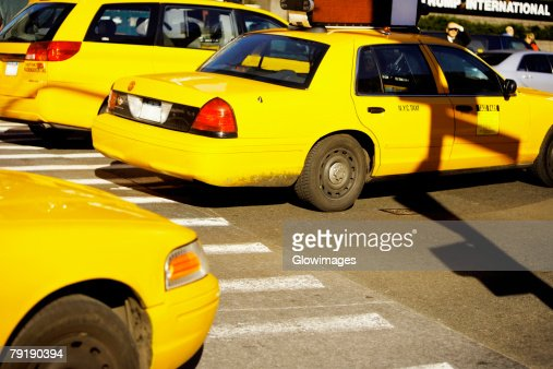 Yellow taxis on a road, Times Square, Manhattan, New York City, New York State, USA : Foto de stock