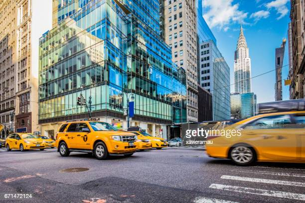 Yellow taxis on busy street in New York City