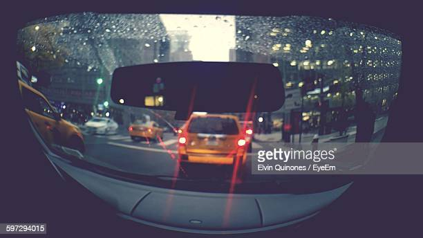 Yellow Taxis Seen Through Car Windshield