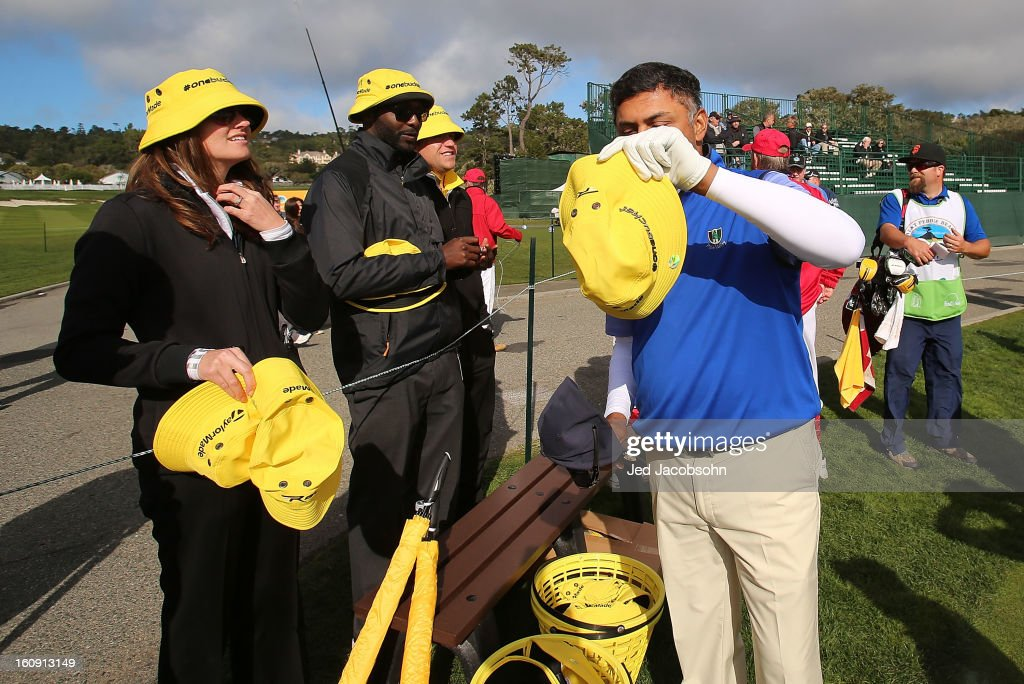 Yellow Taylor Made bucket caps are passed out on the 17th hole during the first round of the AT&T Pebble Beach National Pro-Am at Pebble Beach Golf Links on February 7, 2013 in Pebble Beach, California.