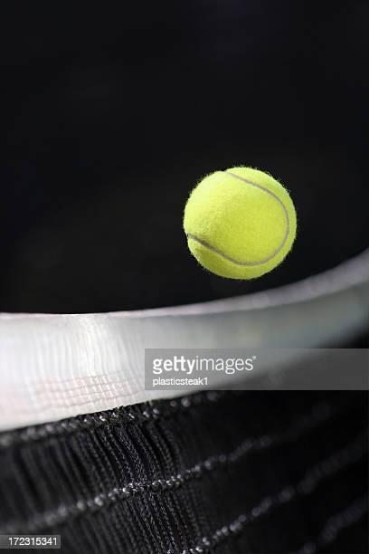 Yellow tennis ball over the net