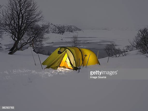 Yellow tent in the snow