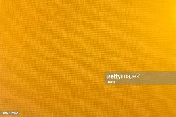 黄色の素材の質感、創造的な抽象的なデザインの背景の写真