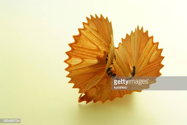 Yellow toned image of heart shape pencil shavings