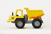 Yellow toy articulated dump truck